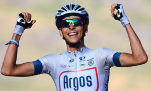 France's Warren Barguil celebrates his victory in the 16th stage of the Vuelta a España.