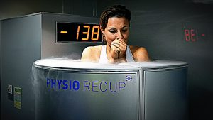 France's midfielder Claire Lavogez stands in a medical device used for cryotherapy at at the French national football team training base in Clairefontaine-en-Yvelines, on May 11, 2015 as part of the preparation for the upcoming FIFA 2015 World Cup. AFP PHOTO / FRANCK FIFE-FRANCE OUT- (Photo credit should read FRANCK FIFE/AFP/Getty Images)