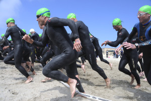 0420 0906 1623 0804 triathletes running on a beach o 300x200 - 080531-n-1722m-839