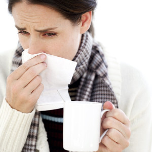 Sick 300x300 - Woman Holding a Mug with a Handkerchief to Her Nose